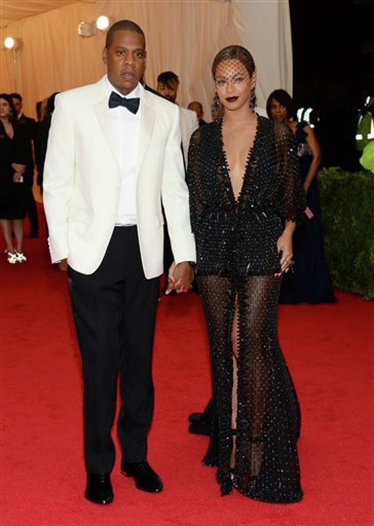 """FILE - This May 5, 2014 file photo shows Jay Z, left, and Beyonce at The Metropolitan Museum of Art's Costume Institute benefit gala celebrating """"Charles James: Beyond Fashion"""" in New York. Beyonce, Jay Z and Solange say they have worked through and are moving on since a video leaked this week of Solange attacking Jay Z in an elevator inside the Standard Hotel after the May 5, gala. (Photo by Evan Agostini/Invision/AP, File)"""