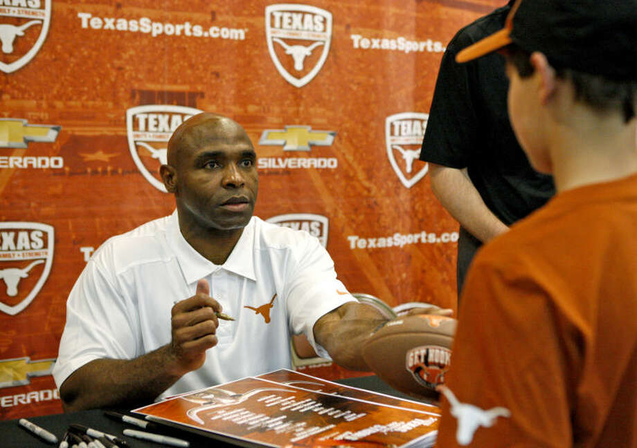 "University of Texas head football coach Charlie Strong signs autographs during a stop in Midland on the ""Texas Comin' on Strong Tour"" Tuesday at the CAF. James Durbin/Reporter-Telegram Photo: James Durbin"