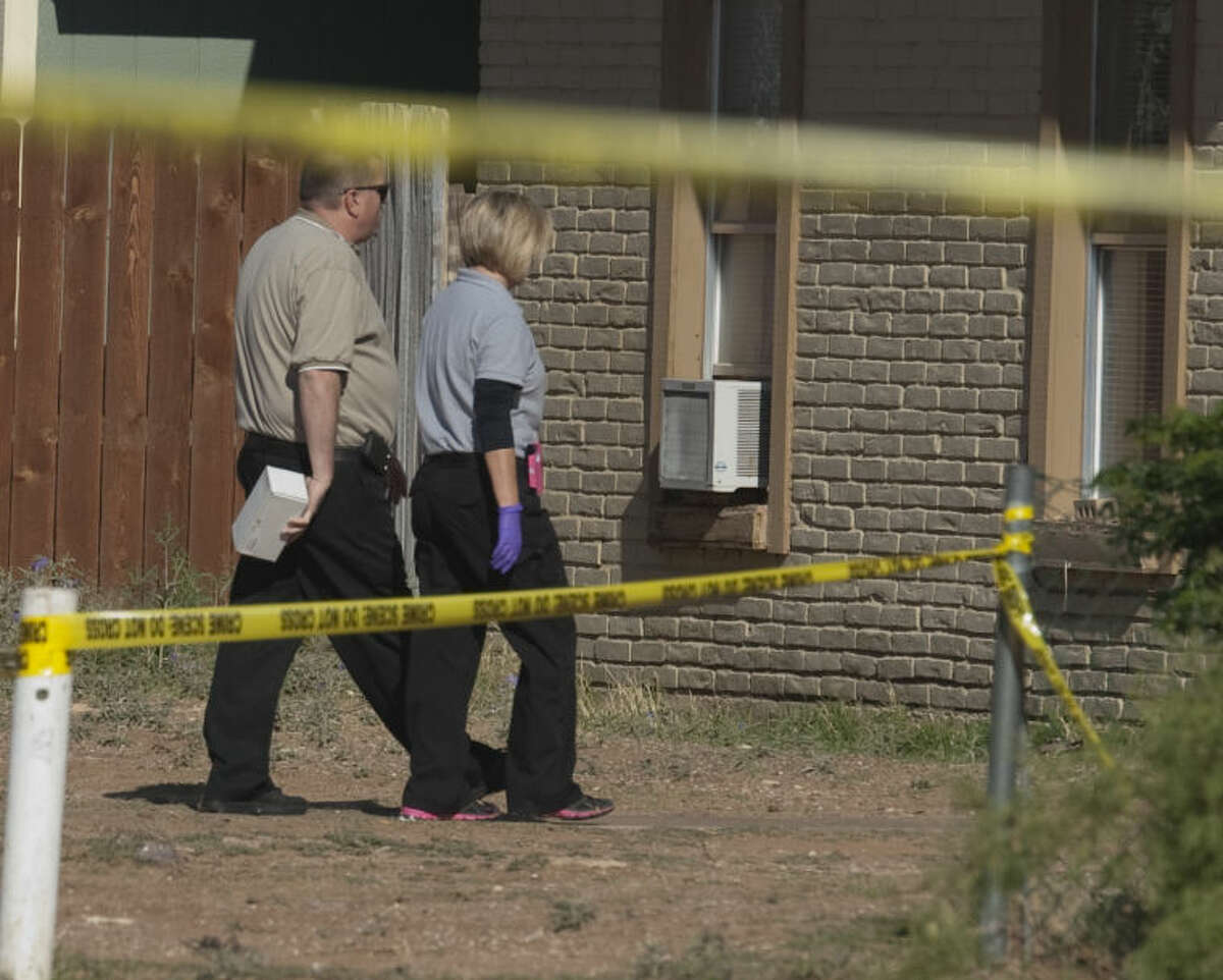 Midland police investigators gather evidence at a shooting Thursday morning in the 500 block of East Cowden.