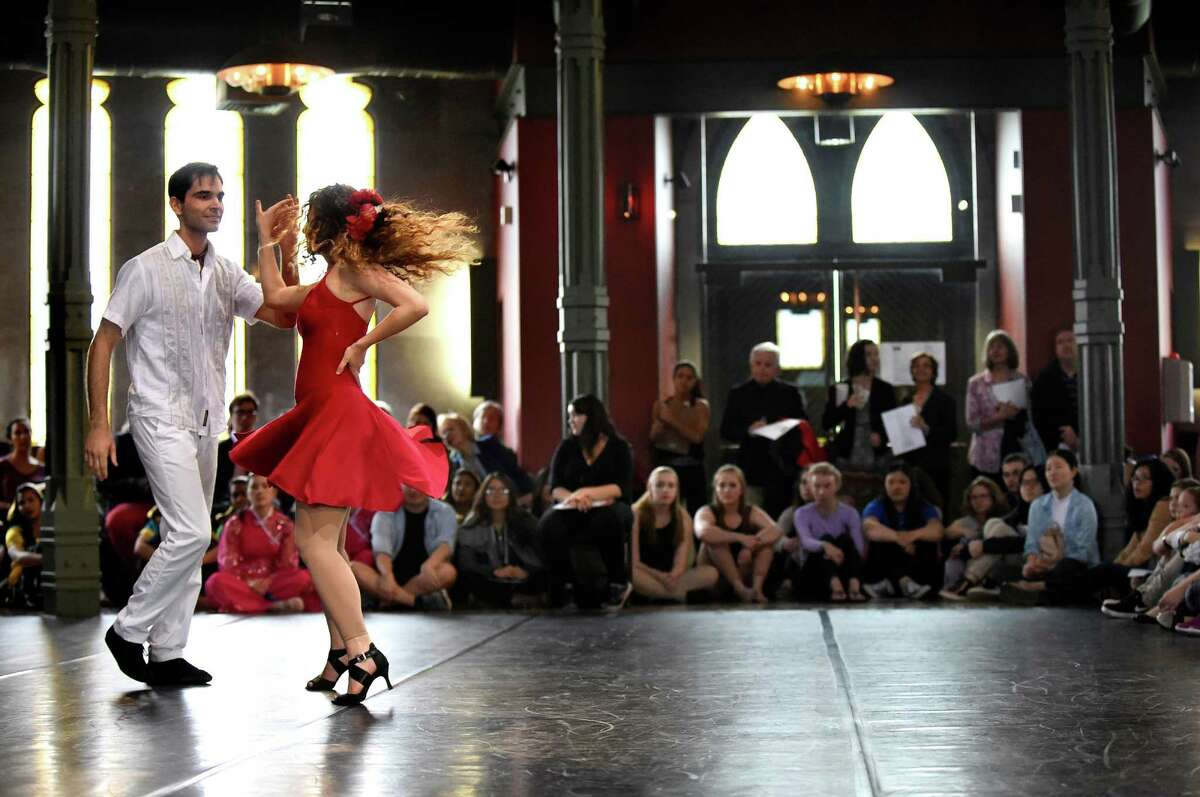 David Aloka, left, and Shannon Windle-Puente dance La Rebelion, choreographed by Juan Soler, during the Lothridge Festival of Dance on Friday, May 6, 2016, at Union College in Schenectady, N.Y. More than 90 performers took to the stage in the Nott Memorial as part of the 26th annual Steinmetz Symposium. (Cindy Schultz / Times Union)