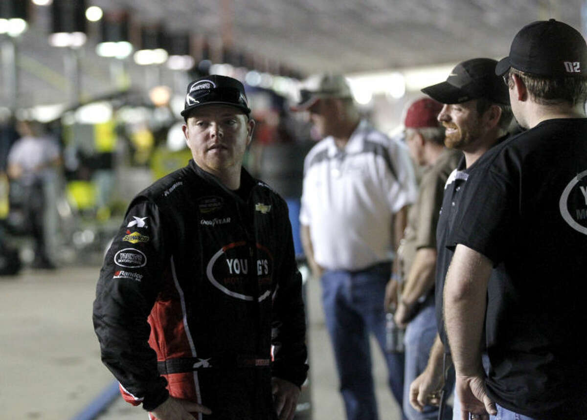 Midlander Tyler Young talks with friends after finishing 19th in the NASCAR Camping World Truck Series WinStar World Casino 400 Friday, June 7 at Texas Motor Speedway. James Durbin/Reporter-Telegram