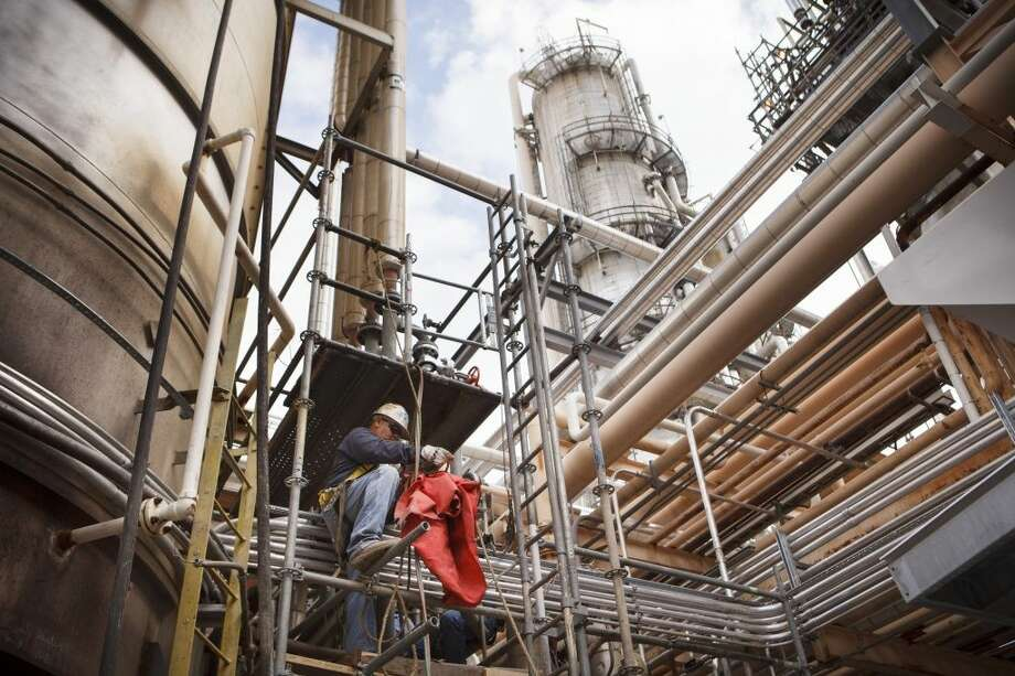 A worker at Valero Energy's refinery in Three Rivers, Texas, Oct. 12, 2012. Refining, once regarded as a low-margin, accident-prone part of the energy industry, is doing better in part because of cheaper natural gas and domestic crude oil. (Michael Stravato/The New York Times) Photo: MICHAEL STRAVATO