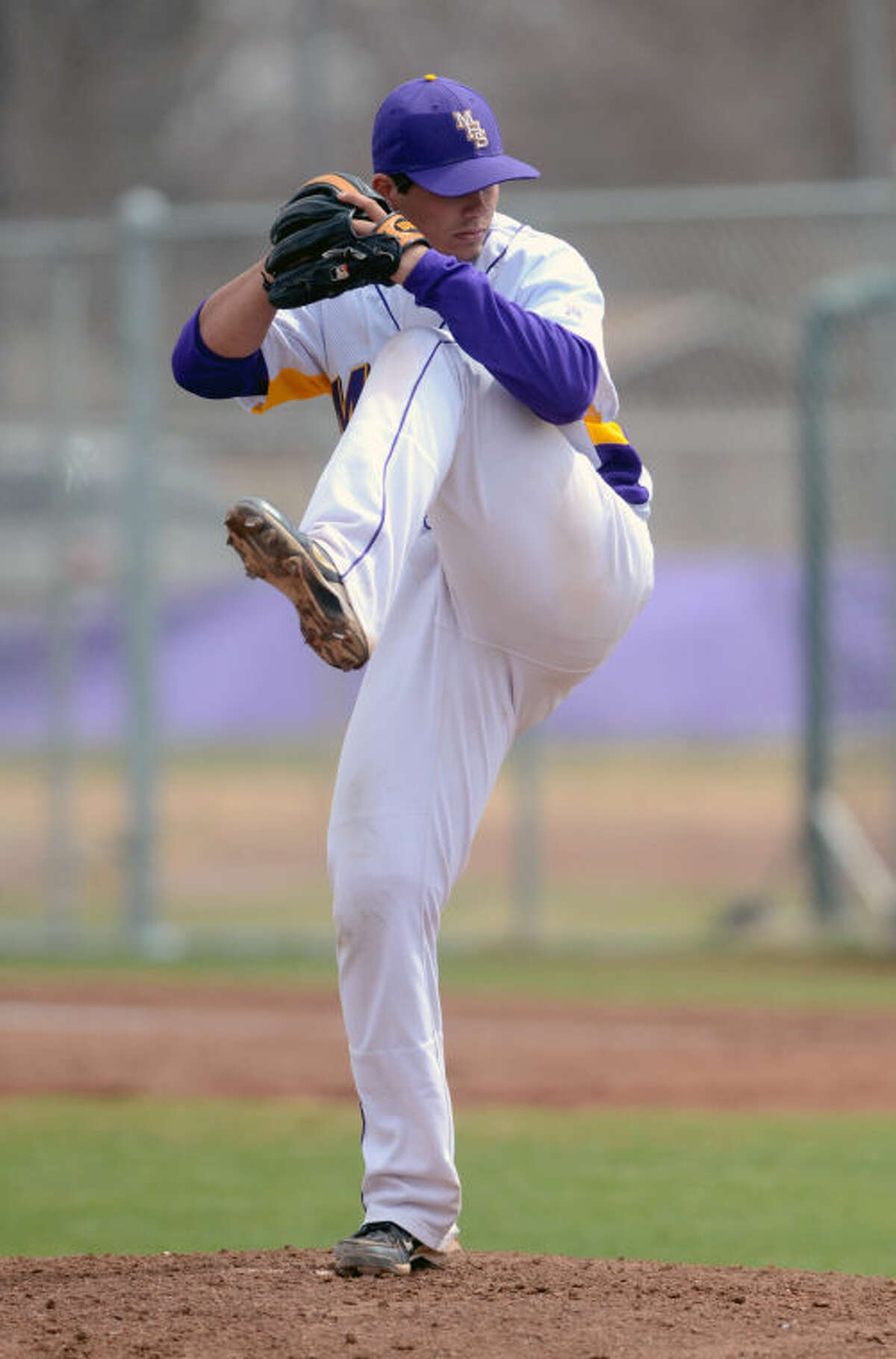 Midland High's Lance White winds up against Odessa High on Saturday at Zachery Field. James Durbin/Reporter-Telegram