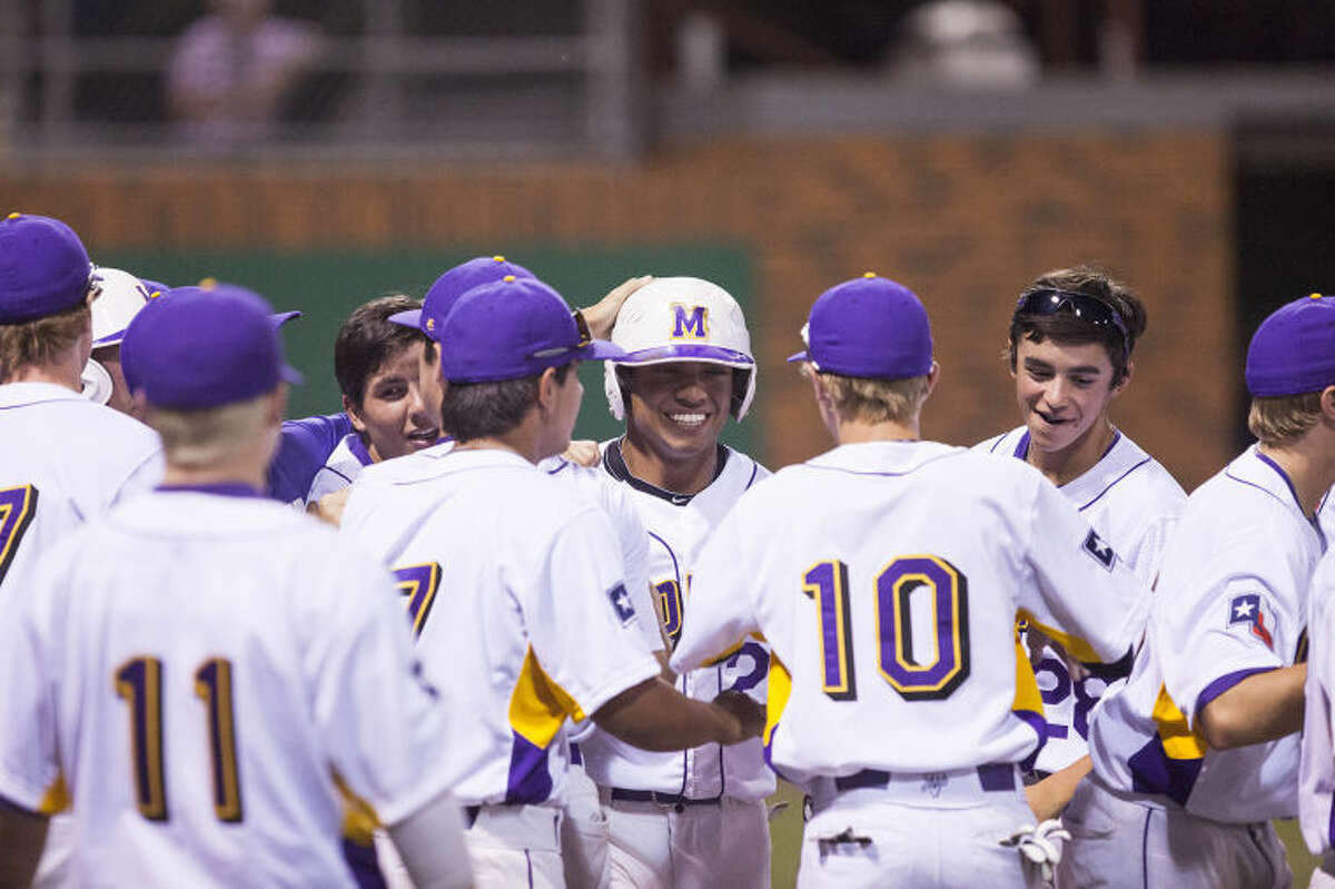 Midland High shortstop Gilbert Sanchez walks back to the dugout after scoring on a two-run single by teammate Jackson Lancaster in the top of the 7th inning of a playoff game against Amarillo Tascosa. photo by Gary Rhodes