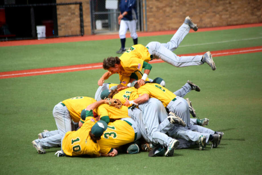 Midland College baseball players do the traditional dogpile after winning the Region V tournament championship on Tuesday at Rip Griffin Park in Lubbock. Shelby Jones/Special to the MRT
