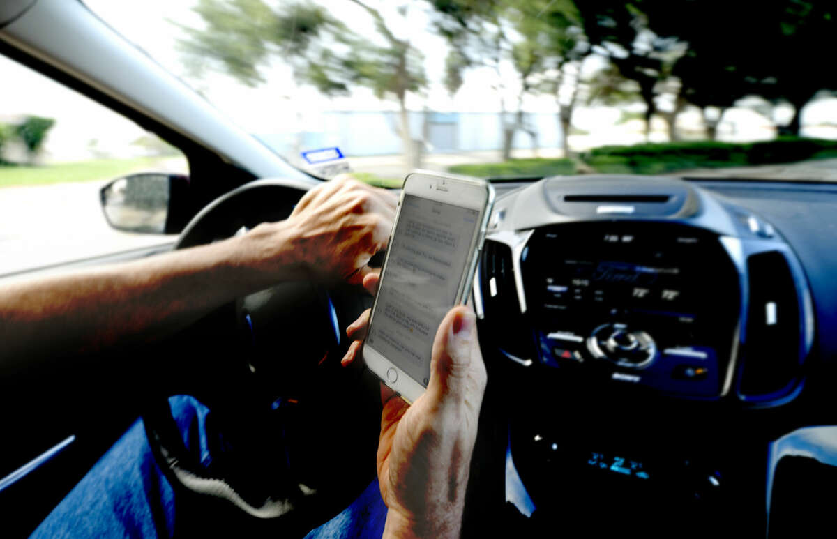 Photo illustration for news story on texting while driving laws, photographed Friday, July 10, 2015, in the parking lot of the Midland Reporter-Telegram. James Durbin/Reporter-Telegram