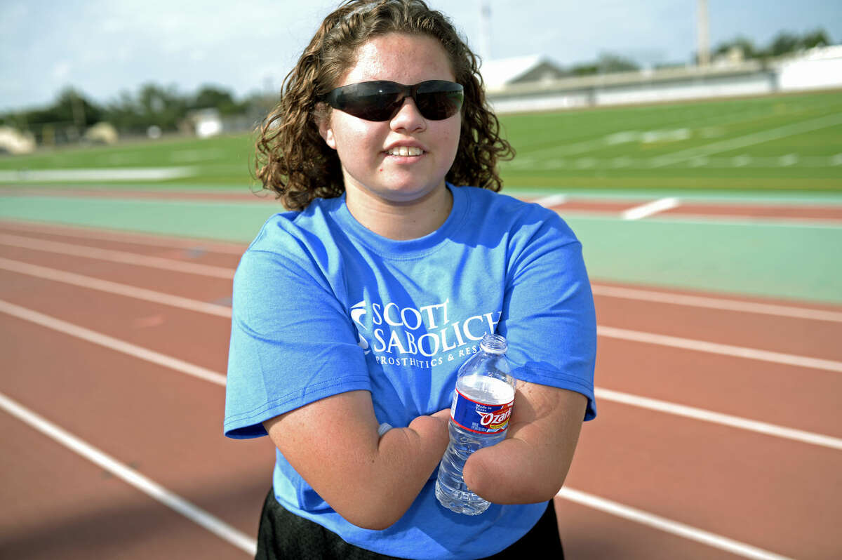 Vanessa Rodriguez pauses for a water break after sprinting during a portrait session with the Reporter-Telegram on Friday, July 10, 2015, at Memorial Stadium. James Durbin/Reporter-Telegram