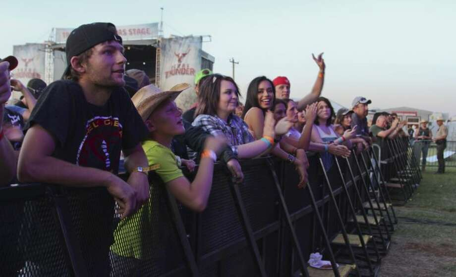 People from across the Permian Basin stopped by Gardendale this weekend to hear several hit country music acts at the 2014 Texas Thunder Country Music Festival. Tyler White/Reporter-Telegram Photo: Tyler White