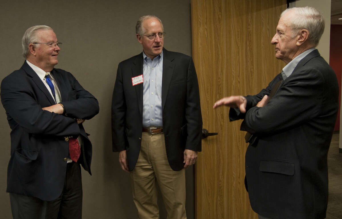 U.S. Rep. Joe Barton, left, talks with U.S. Rep Mike Conaway and Ernie Angelo in May during a luncheon at Henry Resources. Tim Fischer\Reporter-Telegram