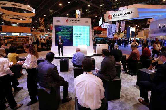 A Cameron representative gives a presentation at the company's booth Monday at the Offshore Technology Conference, which had its lowest turnout since 2009.