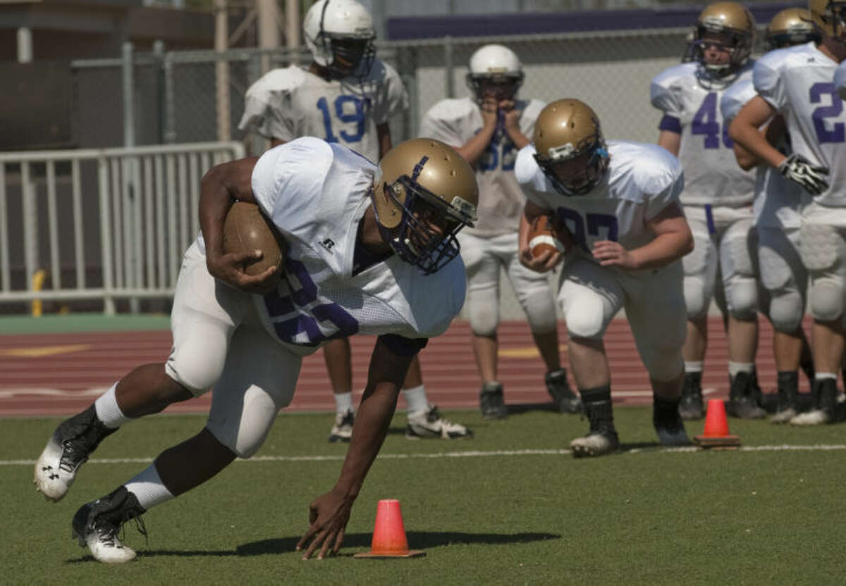 Midland High players run drills Monday on the first day of Spring football practice. Tim Fischer\Reporter-Telegram