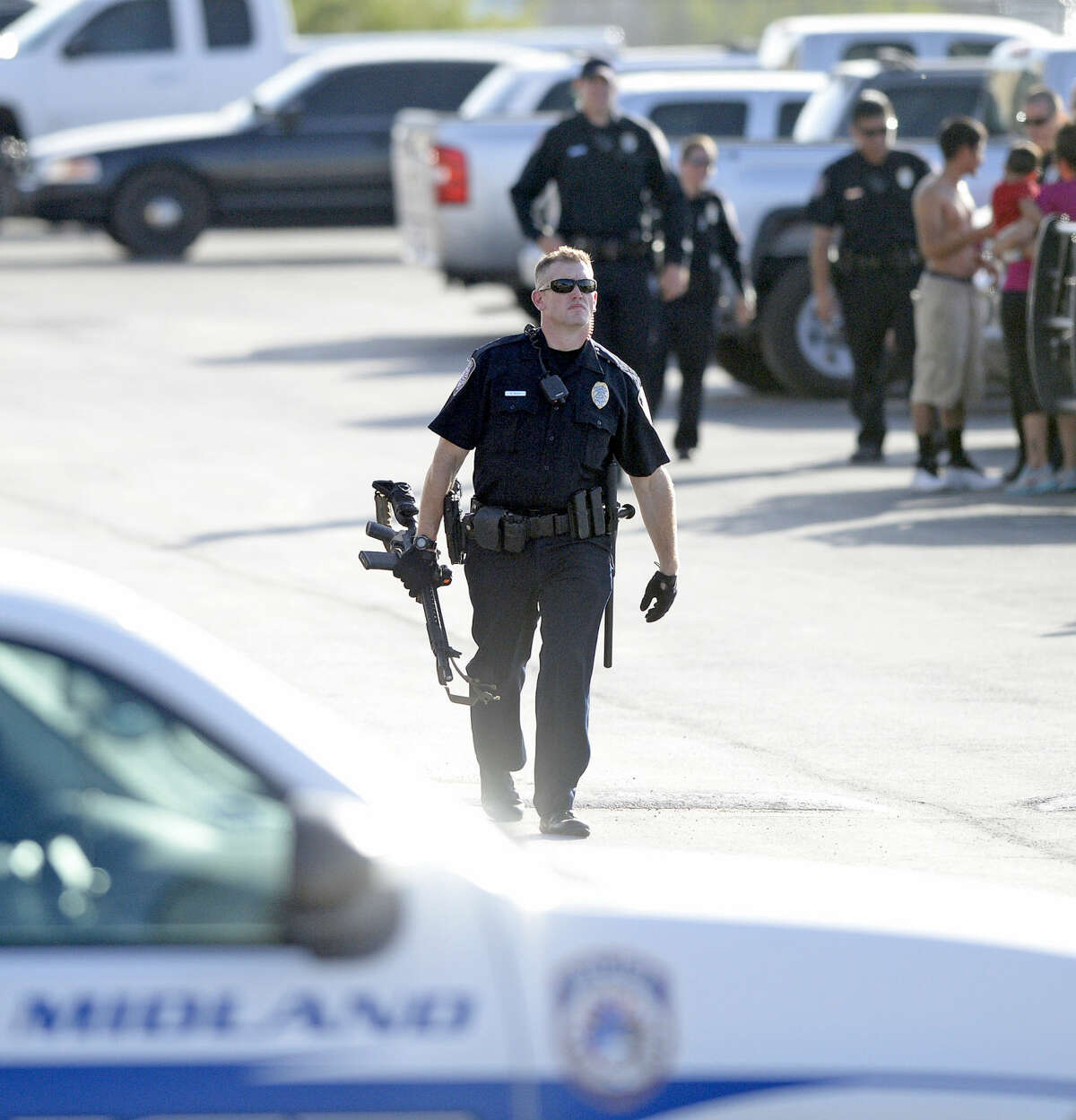 Midland police officers respond to a domestic disturbance at the Waterford Lakes apartments Tuesday, July 14, 2015. One subject was brought into custody with assistance from a police canine. Two of the subjects involved are being investigated for other crimes throughout the Permian Basin. James Durbin/Reporter-Telegram