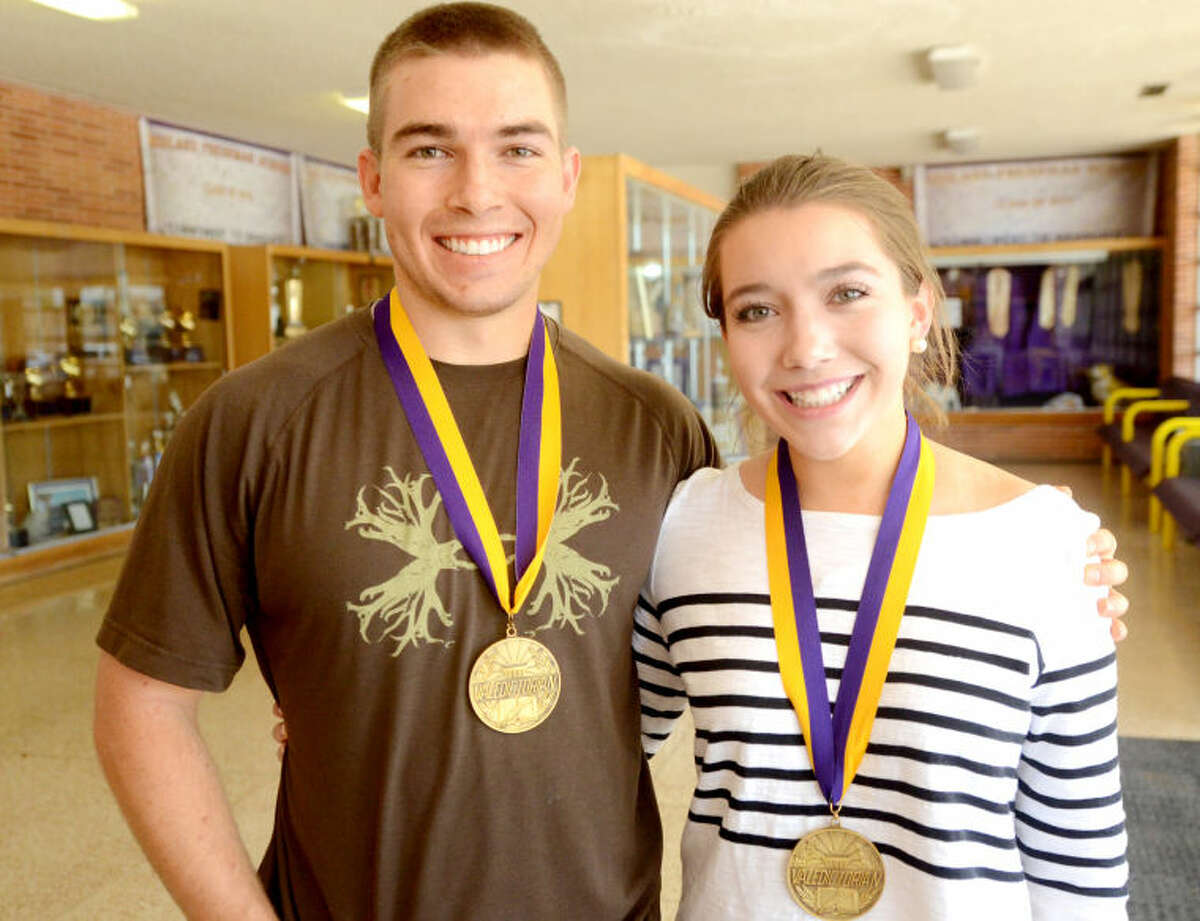 Midland High valedictorian Cora Drozd poses for a photo with her brother, Hunter Drozd, a past MHS valedictorian, Thursday at Midland High. James Durbin/Reporter-Telegram