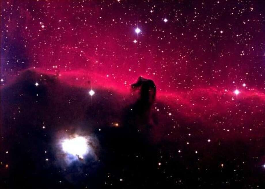 Lying just below the belt of Orion, the Horsehead Nebula is actually two nebulae, one lying in front of the other. The foreground nebula, which includes the horsehead figure, appears dark because there are no nearby stars to illuminate it. The background nebula emits the characteristic red light of hydrogen, caused to glow by the energy of nearby stars. The Horsehead is also known as IC 434. This image was made with the 0.8-meter Telescope at McDonald Observatory, with the Prime Focus Corrector instrument. Credit: Tom Montemayor/McDonald Observatory Photo: Tom Montemayor