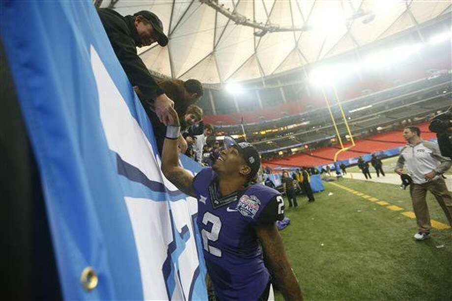 TCU quarterback Trevone Boykin greets fans after the second half of the Peach Bowl NCAA football game, Wednesday, Dec. 31, 2014, in Atlanta. TCU won 42-3. (AP Photo/John Bazemore) Photo: John Bazemore