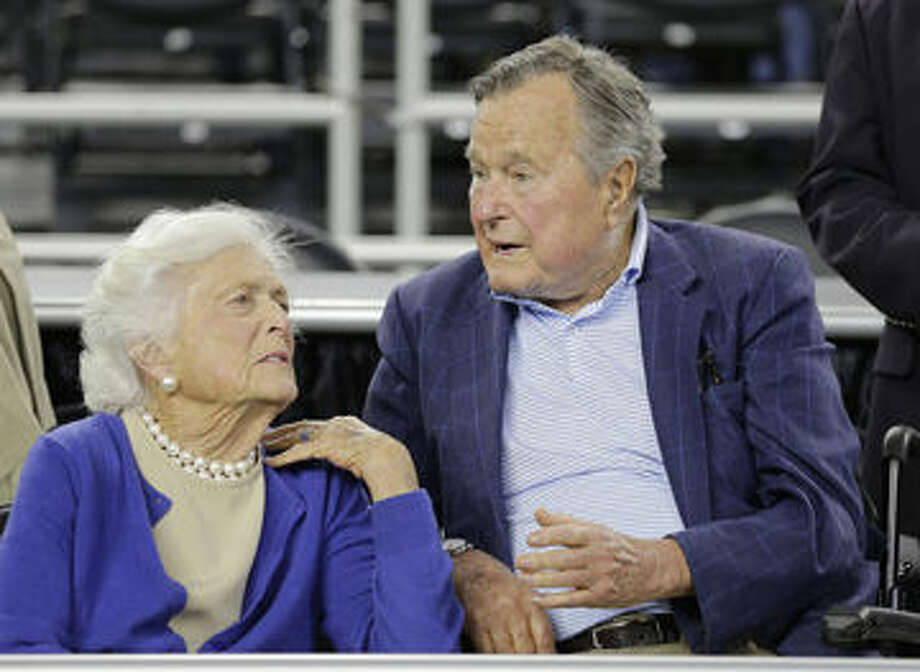 In this March 29 file photo, former President George H.W. Bush and his wife, Barbara, are seen at a college basketball regional final game between Gonzaga and Duke, in the NCAA basketball tournament in Houston. Bush fell at home Wednesday in Kennebunkport, Maine, and broke a bone in his neck. Photo: AP File Photo