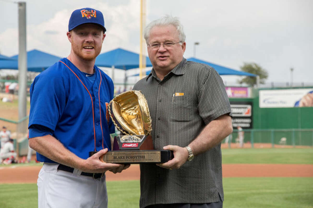 Midland RockHounds catcher Blake Forsythe, left, is presented his Rawlings Gold Glove Award for the 2013 season prior to Thursday night's RockHounds game at Security Bank Ballpark. Minor League Baseball President and CEO Pat O'Connor is on the right. Photo by Cassie Thornton