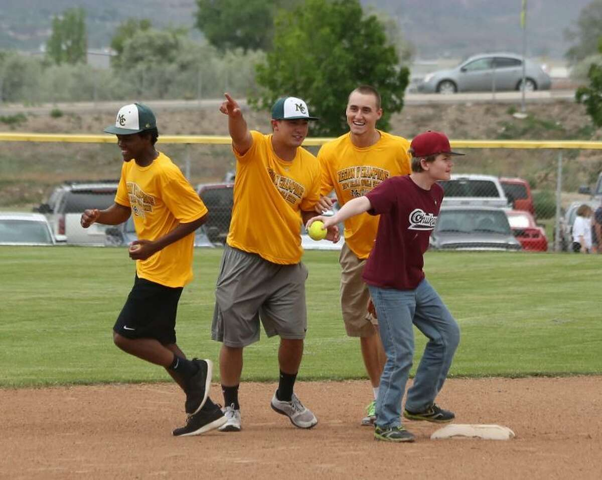 From left, Midland College baseball players Richie Furline, Daniel Vargas and Chris Thibideau help give directions to a Chukars player during a Challenger Baseball event at the Canyon View Park baseball fields in Grand Junction, Colo. Forrest Allen/Courtesy Photo