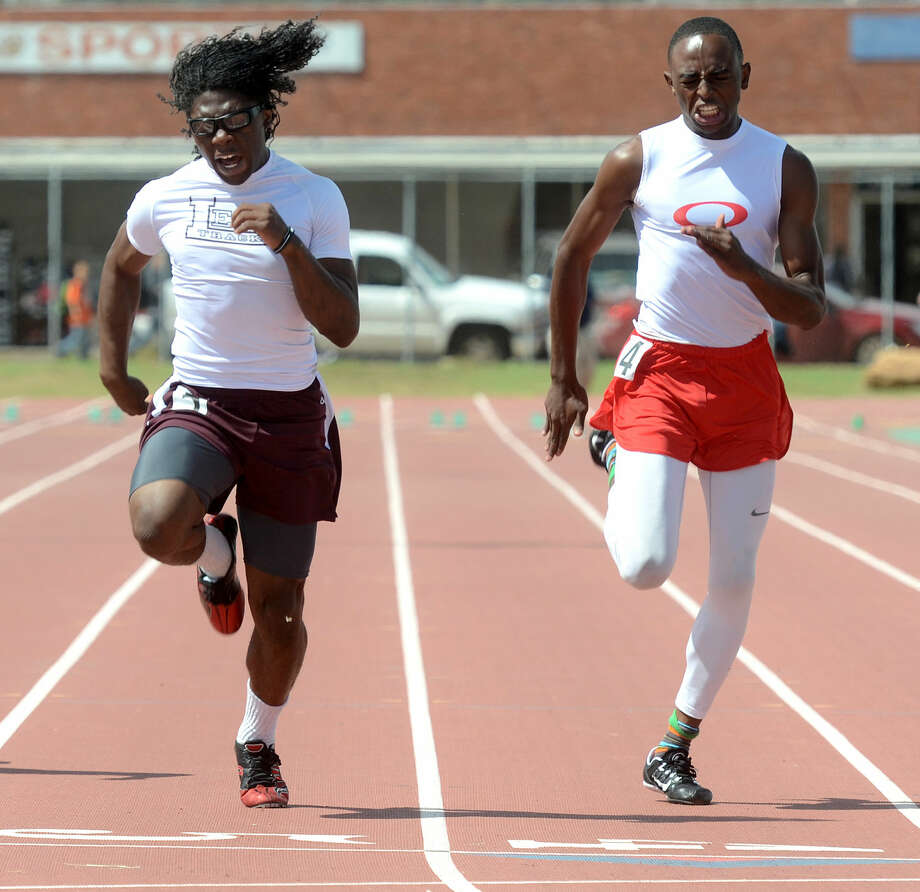 Lee High's Terry Sims crosses the finish line in the 100 meter dash during the District 3-6A Track and Field Championships on Friday, April 17, 2015 at Memorial Stadium. James Durbin/Reporter-Telegram Photo: James Durbin