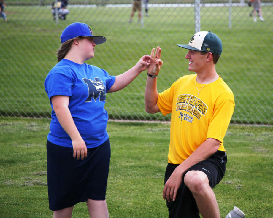 MC Baseball player Daniel Crooks works with a player during the Challenger Baseball program in Grand Junction, Colo., on Thursday. Forrest Allen/MC Athletics