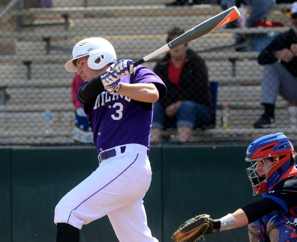 Midland High's Braden Rushton hits against Abilene Cooper on Saturday at Zachery Field. James Durbin/Reporter-Telegram