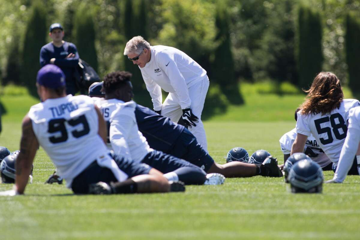 Head coach Pete Carroll talks to players as they stretch during the first day of the Seattle Seahawks NFL football rookie minicamp on Friday, May 6, 2016 at Virginia Mason Athletic Center. (GRANT HINDSLEY, seattlepi.com)