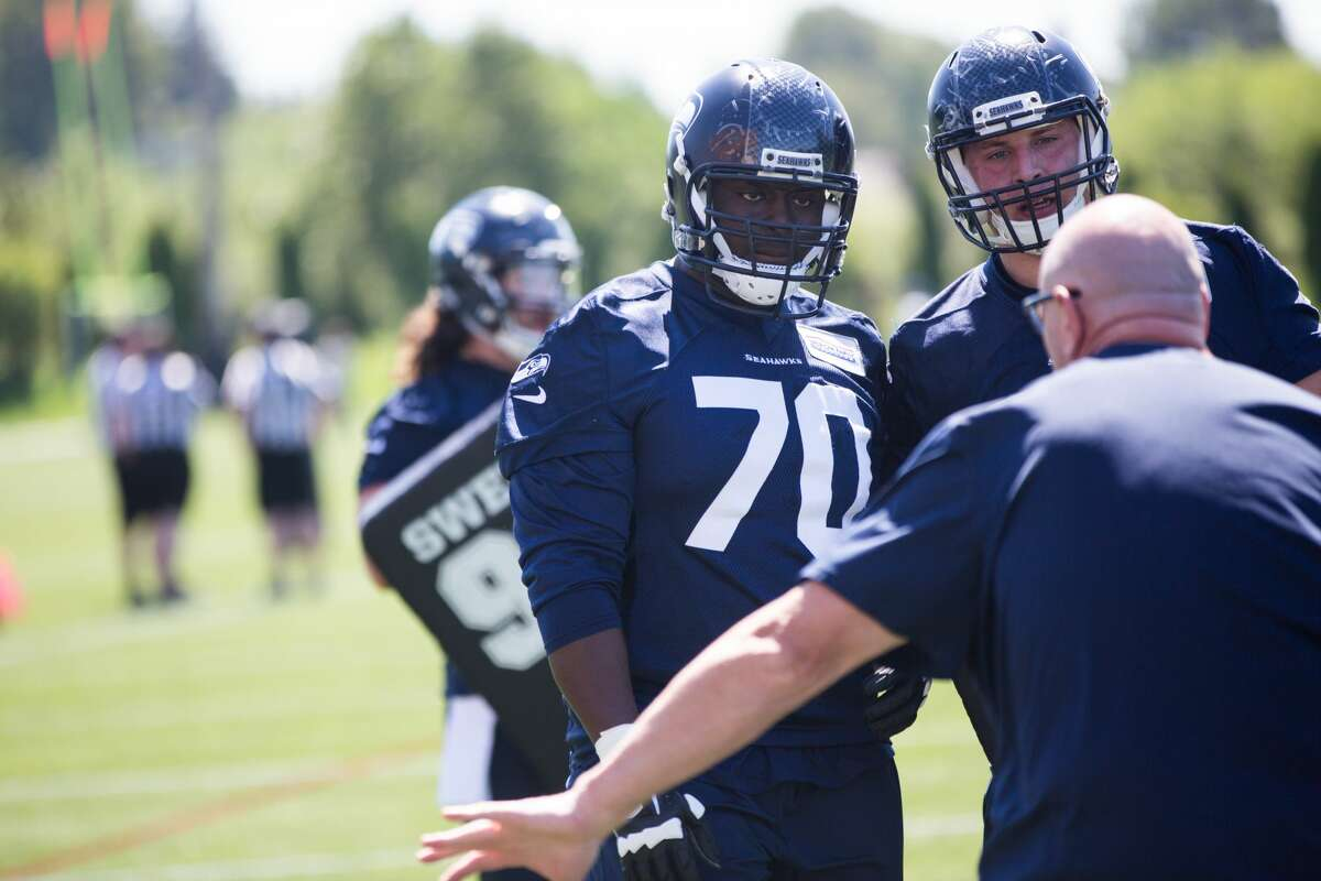 Rookie guard Rees Odhiambo, left, listens to a coach during the first day of the Seattle Seahawks NFL football rookie minicamp on Friday, May 6, 2016 at Virginia Mason Athletic Center. (GRANT HINDSLEY, seattlepi.com)