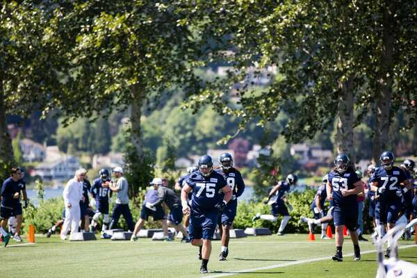 Players move about the practice field during the first day of the Seattle Seahawks NFL football rookie minicamp on Friday, May 6, 2016 at Virginia Mason Athletic Center. (GRANT HINDSLEY, seattlepi.com)