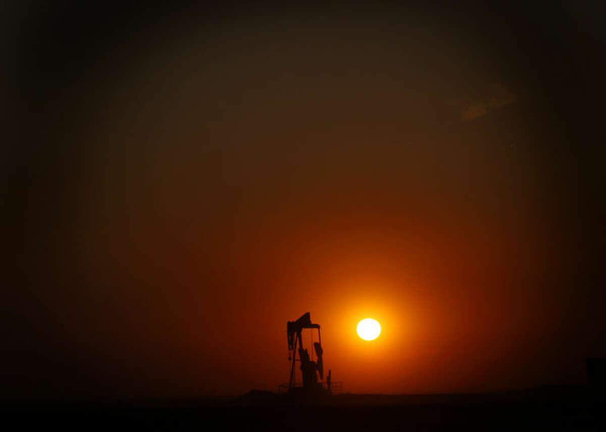 The sun sets behind a pumpjack near FM 829 in Stanton on Wednesday. James Durbin/Reporter-Telegram