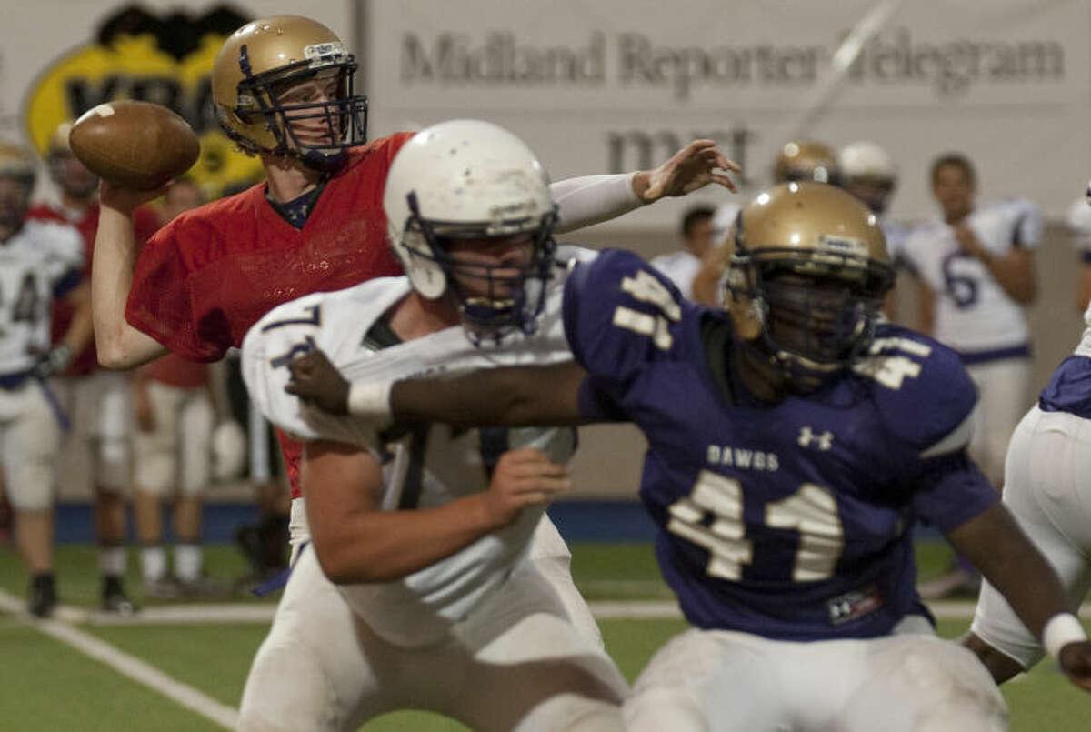 Midland High quarterback Brady Bolger looks to pass Thursday evening during the Spring game at Grande Communications Stadium. Tim Fischer\Reporter-Telegram