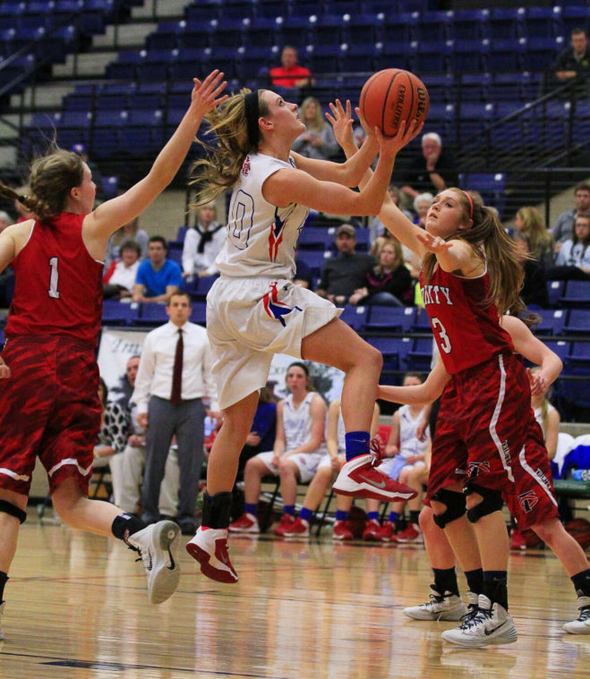 Lady Mustangs guard Morgan Ashton (10) goes to the basket during a TAPPS 4A Semifinal girls basketball game between the Midland Christian Lady Mustangs and the Lubbock Trinity Lady Lions at Lake Ridge High School in Mansfield, TX on Friday, February 28, 2014. (Photo by Ray Carlin)
