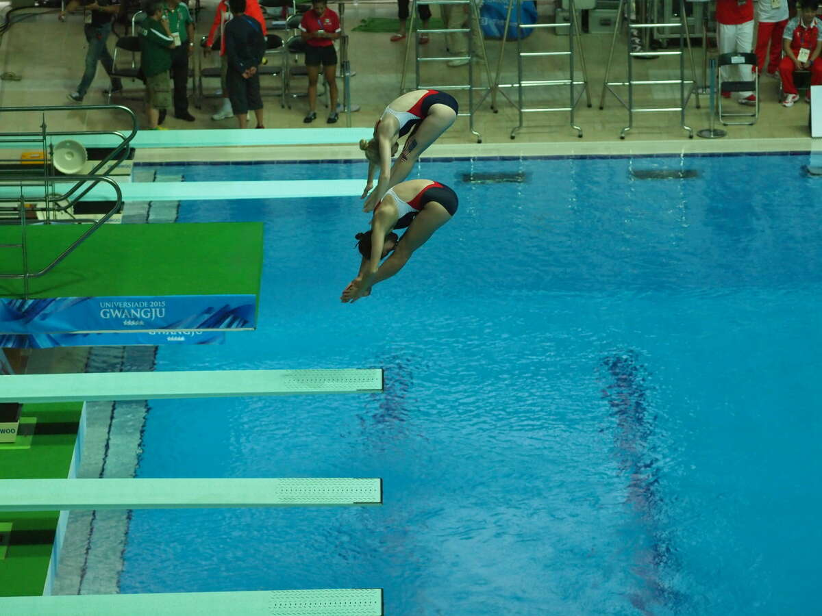 Midland Christian grad and former City of Midland diver Haley Allen (top) is shown here diving with partner Olivia Rosendahl in the 3-meter synchronized diving event during the World University Games held in Gwangju City, South Korea, earlier this month. Courtesy Photo