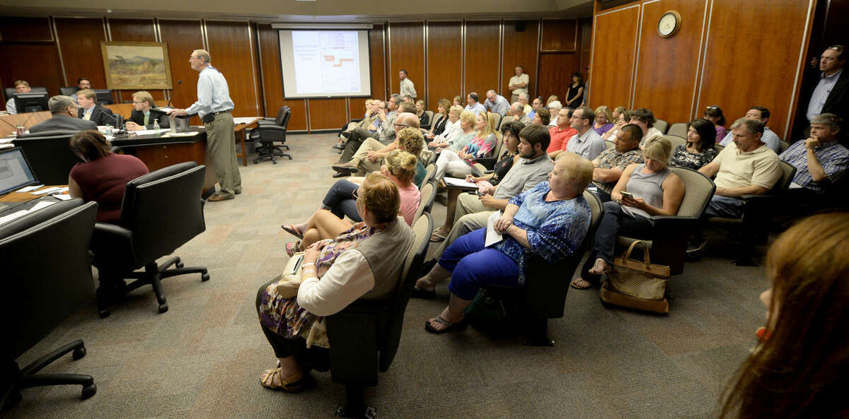 The Midland City Council chamber was full of citizens wishing to express their opinions about the proposed development of the greenbelt, Monday, July 20, 2015. James Durbin/Reporter-Telegram