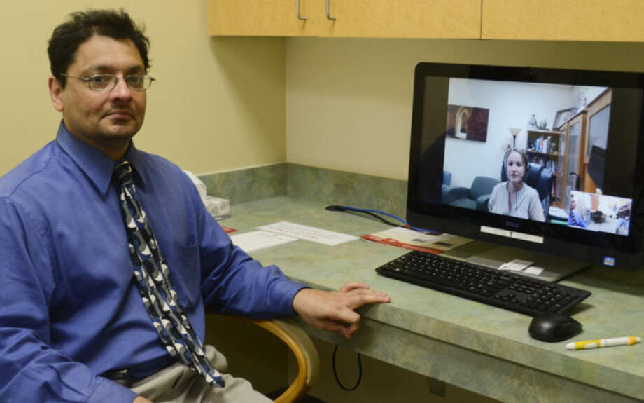 Dr. Bobby Jain, with Texas Tech Physicians, shows the computer used for patients to talk with psychiatrists in Lubbock. Tim Fischer\Reporter-Telegram Photo: Tim Fischer