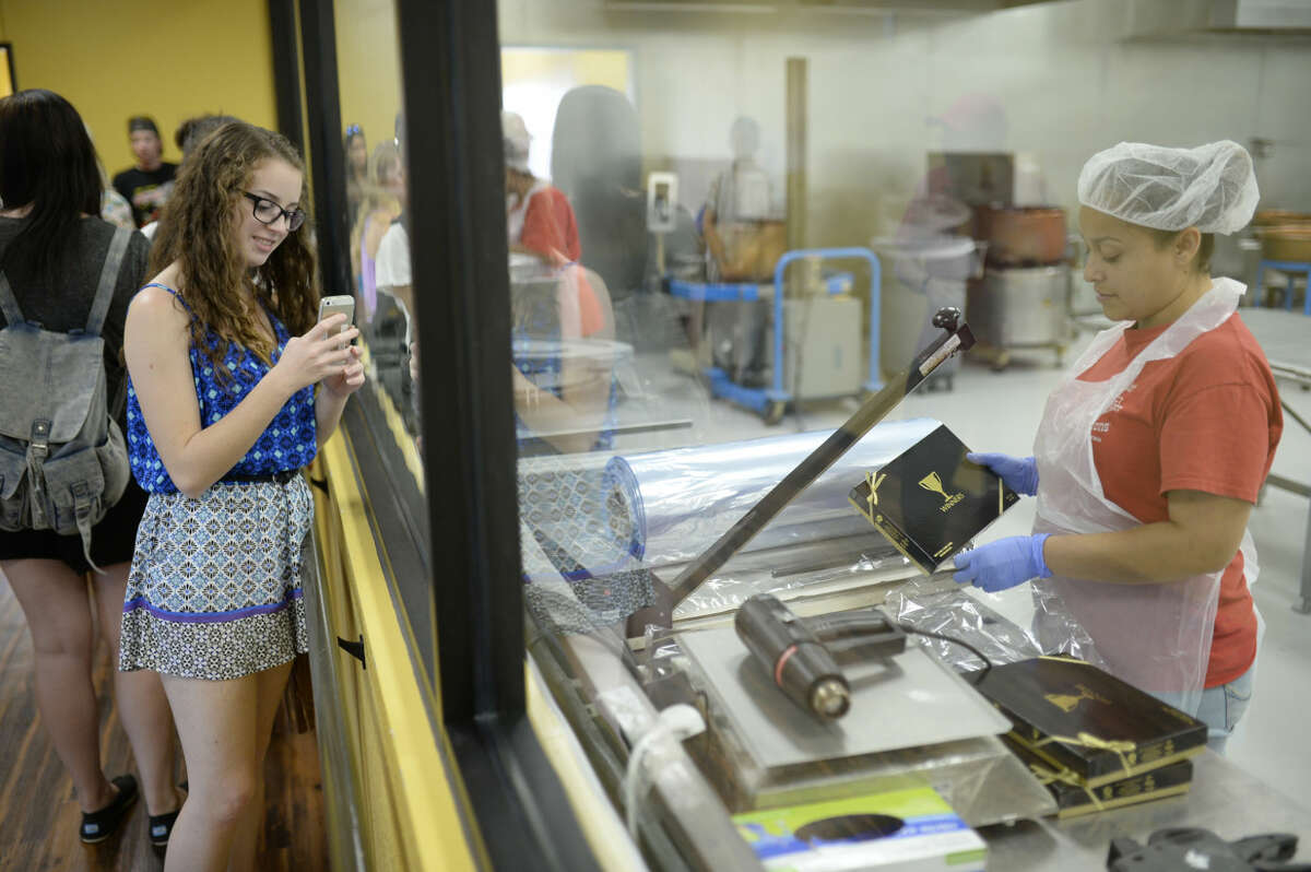 Downtown Lion's Club exchange student, Luana Gasperotto, from Brazil, visits Susie's South Forty on Friday, July 10, 2015. James Durbin/Reporter-Telegram