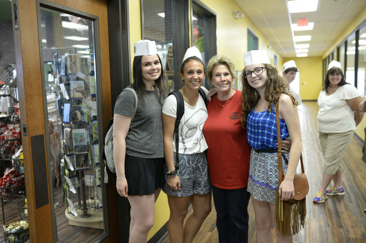 Susie Hitchcock-Hall, owner of Susie's South Forty, poses for a picture with Downtown Lion's Club exchange students from left, Sanni Saarelainen of Finland, Alessia Martini of Italy, and Luana Gasperotto of Brazil (far right) during a visit to Susie's South Forty on Friday, July 10, 2015. James Durbin/Reporter-Telegram