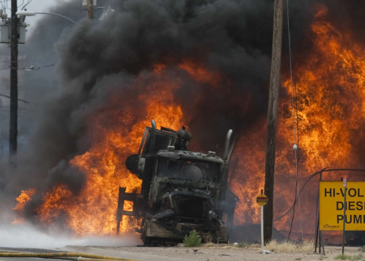 Midland firefighters battle a fuel fire on an oil field truck Saturday on Rankin Highway just south of I-20. Tim Fischer\Reporter-Telegram