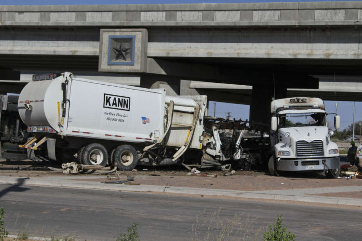 A City of Midland sanitation driver was pronounced dead at the scene of this two-vehicle crash Tuesday afternoon on East Loop 250 near Interstate 20 in Midland County. Tyler White/Reporter-Telegram