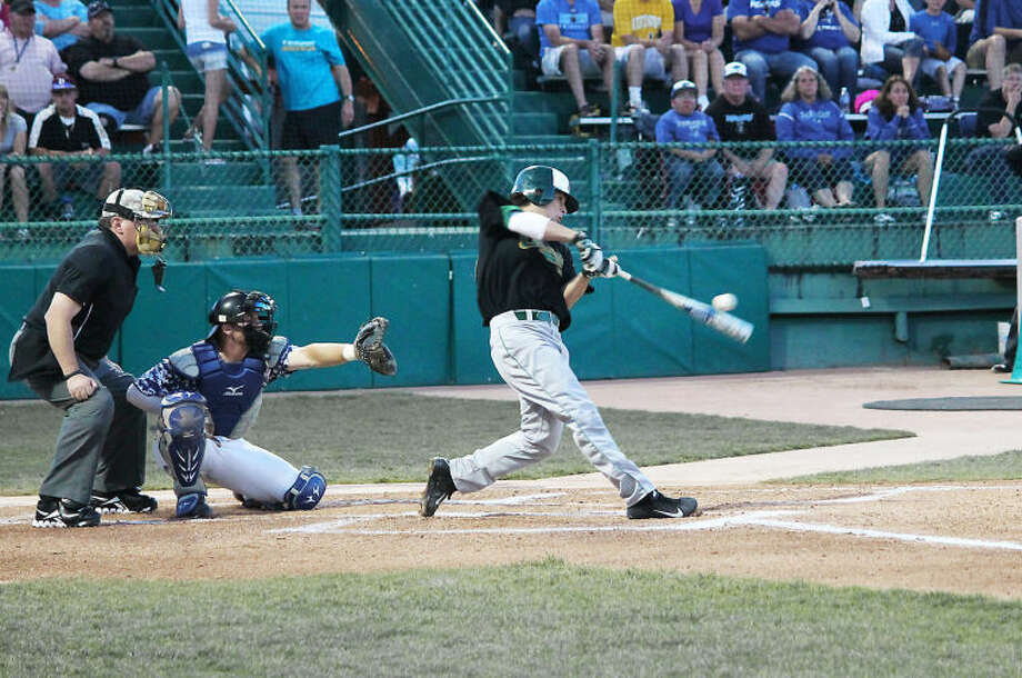 Midland College's Justin Clarkson makes contact with a ball on Monday night against Iowa Western at the JUCO World Series in Grand Junction, Colo.