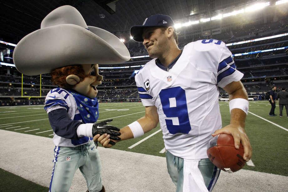 Dallas Cowboys quarterback Tony Romo (9) celebrates with team mascot, Rowdy after beating the Philadelphia Eagles 38-33 at NFL football game Sunday, Dec. 2, 2012 in Arlington, Texas. (AP Photo/Tony Gutierrez) Photo: Tony Gutierrez