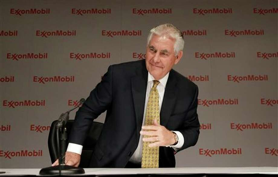 ExxonMobil CEO Rex Tillerson concludes an availability with reporters after the annual meeting ExxonMobil shareholders meeting in Dallas, Wednesday, May 28, 2014. (AP Photo/LM Otero) Photo: LM Otero / AP
