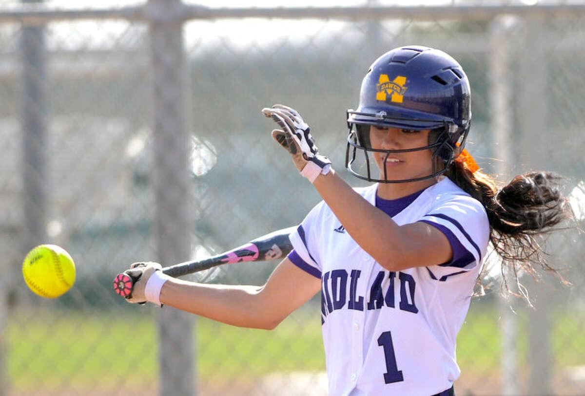 Midland High's Leandra Lopez hits against Amarillo Tascosa on Friday at Audrey Gill Sports Complex. James Durbin/Reporter-Telegram