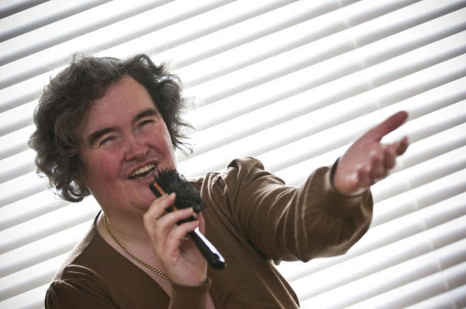 "FILE - In this April 16, 2009 file photo, Susan Boyle, whose performance on the television show ""Britain's Got Talent"" wowed the judges, poses singing with a hairbrush at her home in Blackburn, Scotland. But what happened next for Susan Boyle? The middle-aged church volunteer from a small town in Scotland became an instant global celebrity in 2009 with her heart-stopping rendition of the ""Les Miserables"" number ""I Dreamed a Dream"" on a TV talent show. A week is a long time in showbiz _ and in our hyper-speed online age three and a half years is an eternity _ but Boyle is still going strong. She has sold millions of records, received an honorary doctorate, sung for Pope Benedict XVI and performed in Las Vegas. A stage musical about her life has played to enthusiastic crowds across Britain and is headed for Australia, and next month she releases her fourth album, ""Standing Ovation."" (AP Photo, File) Photo: STR"