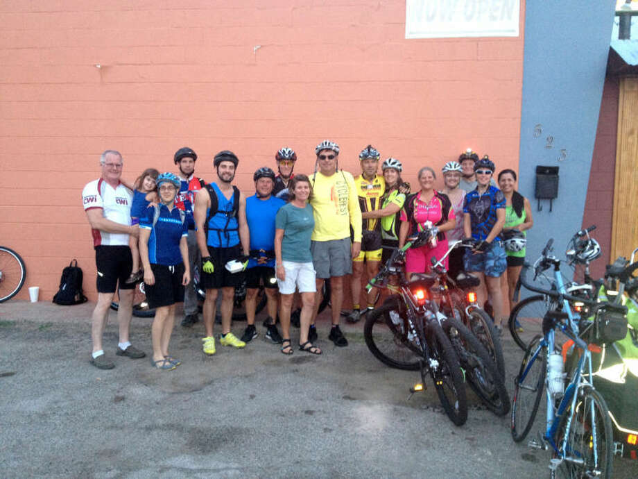 Riders pose for a group picture outside Casa Del Sol restaurant during a City Ride event August 22, 2013. Photo courtesy of Peytons Bikes.
