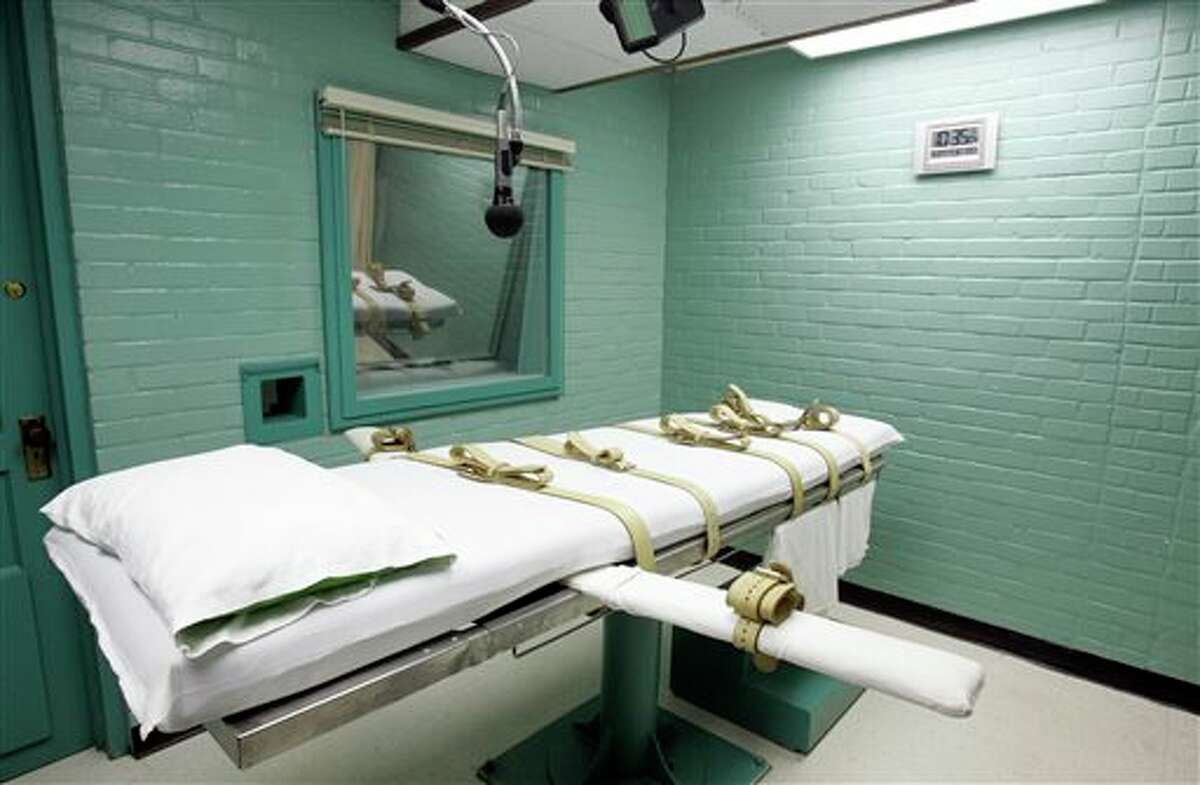 """FILE - This May 27, 2008 file photo shows a gurney the death chamber in Huntsville, Texas. Texas can keep secret the name of its supplier for its execution drugs, the state attorney general determined Thursday, May 29, 2014, after law enforcement argued that suppliers face serious danger. In the decision, Attorney General Greg Abbott's Office cited a """"threat assessment"""" signed by Texas Department of Public Safety director Steven McCraw that says pharmacies selling execution drugs face """"a substantial threat of physical harm."""" (AP Photo/Pat Sullivan, File)"""