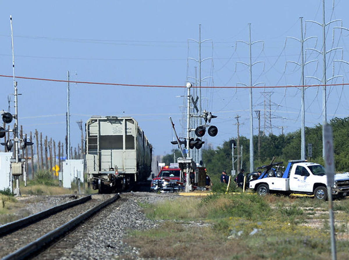 Midland emergency personnel work the scene of a fatal crash with a Union Pacific train near the intersection of East Front Ave. and N. Carver Street, Saturday, July 18, 2015. James Durbin/Reporter-Telegram