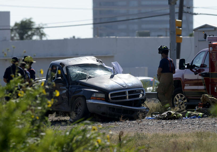 Midland emergency personnel work the scene of a fatal crash with a Union Pacific train near the intersection of East Front Ave. and N. Carver Street, Saturday, July 18, 2015. James Durbin/Reporter-Telegram Photo: James Durbin