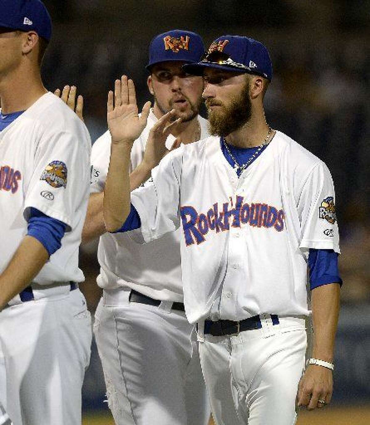 Rockhounds pitcher Dillon Overton high-fives teammates after a win against San Antonio on Thursday, July 23, 2015 at Security Bank Ballpark.