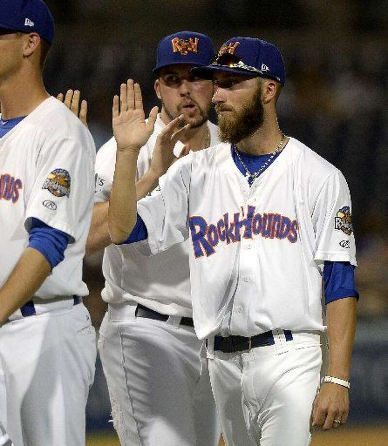 Rockhounds pitcher Dillon Overton high-fives teammates after a win against San Antonio on Thursday, July 23, 2015 at Security Bank Ballpark. Photo: James Durbin/Reporter-Telegram
