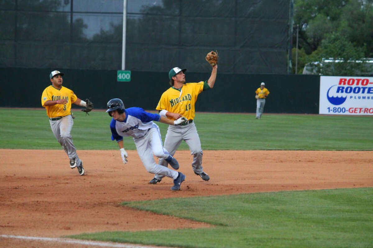 Midland College's Justin Clarkson, left, fields a ball during Thursday's game against Iowa Western at the JUCO World Series on Thursday. JoJo Collazo is in the background of the play.Photo by Buddy Brown/Special to the MRT